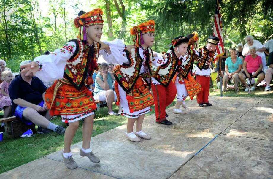 The Ukrainian dance group, Kalynonka, from Stamford entertain festival goers Sunday at the Ukrainian Festival, held at the Paproski's Christmas Tree Farm in Newtown, Sunday, August 29, 2010. Photo: Carol Kaliff / The News-Times