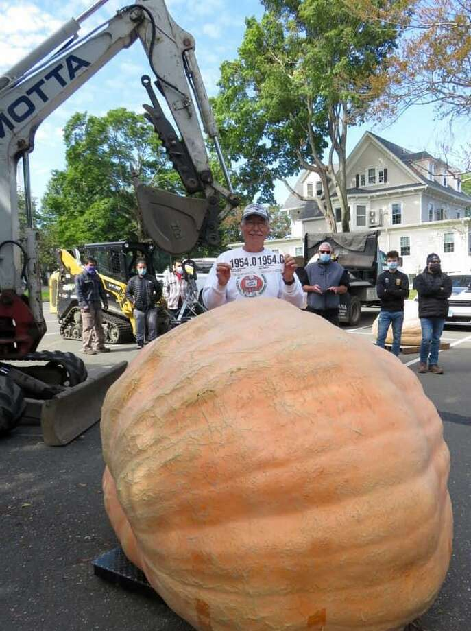 The top pumpkin weighed in at 1,954 lbs and was grown by Joe Jutras of N. Scituate, R.I. Photo: Jessica Collins
