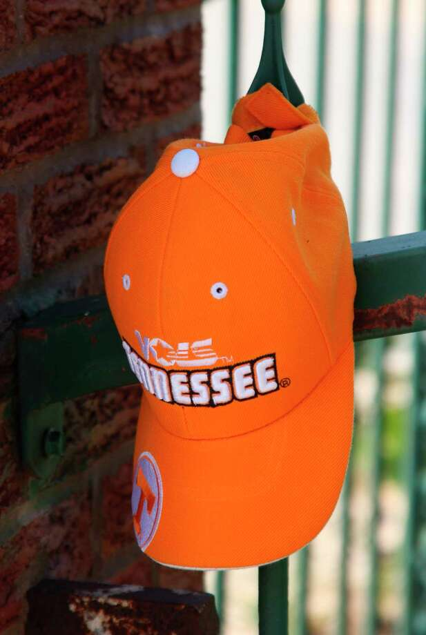 A University of Tennessee Volunteers hat is tied to the fence of a private residence near the entrance to Frankfort Beach as part of a memorial for a boy from Tennessee who got swept off the pier and disappeared. (Photo/Colin Merry)