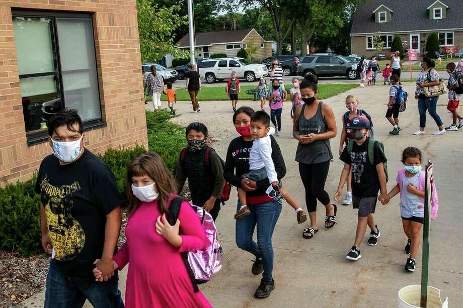 Holland students return to Jefferson Elementary School on Wednesday, Aug. 26, 2020. (Cory Morse/TNS) / mlive.com