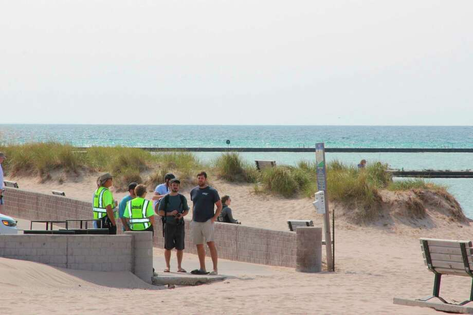 Benzie County CERT team members talk to people on Frankfort Beach on Sept. 22. (Photo/Colin Merry)