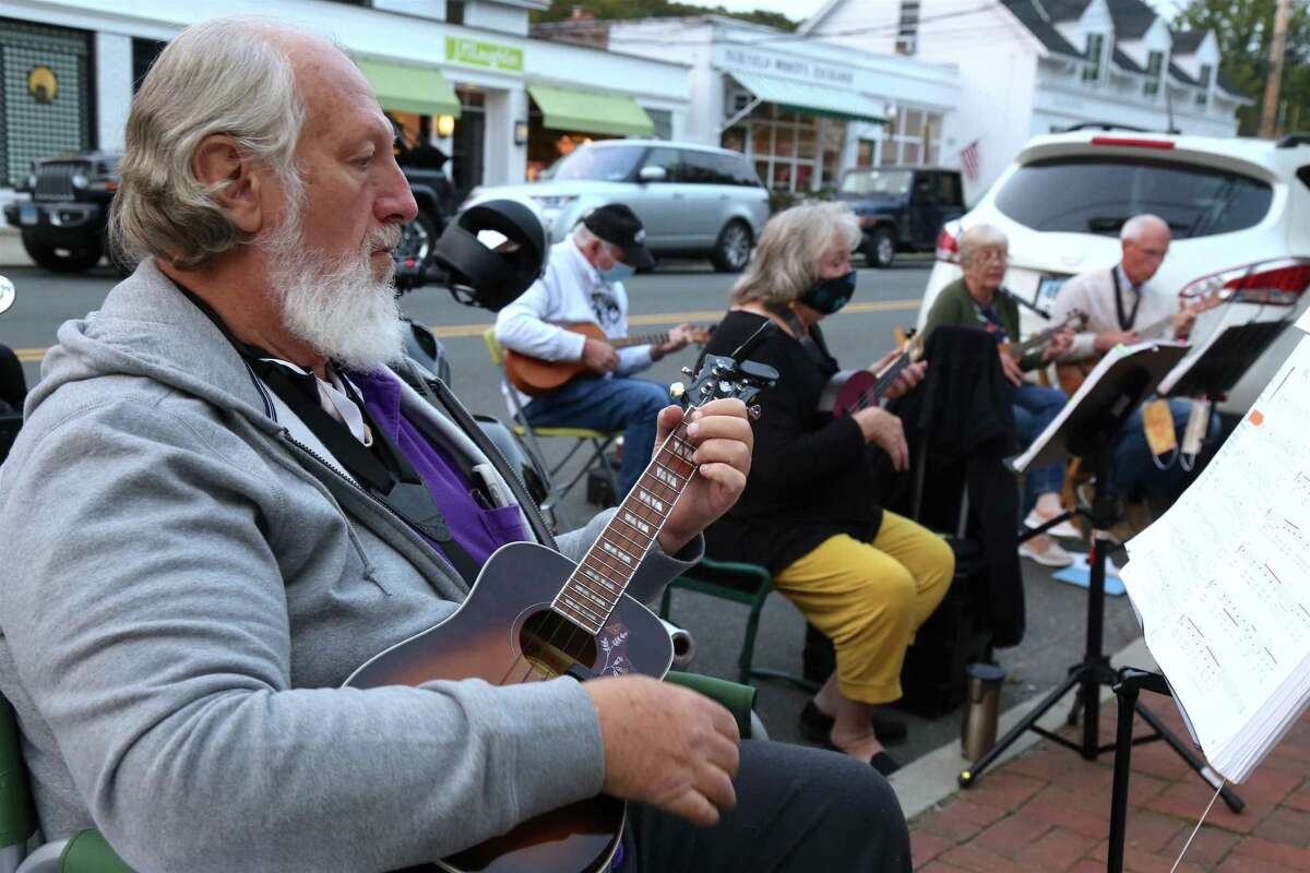 John Pyrch of Black Rock and others sing and play at the monthly ukulele meet-up outisde the Horseshoe Cafe on Tuesday, Sept.15, 2020, in Fairfield, Conn.