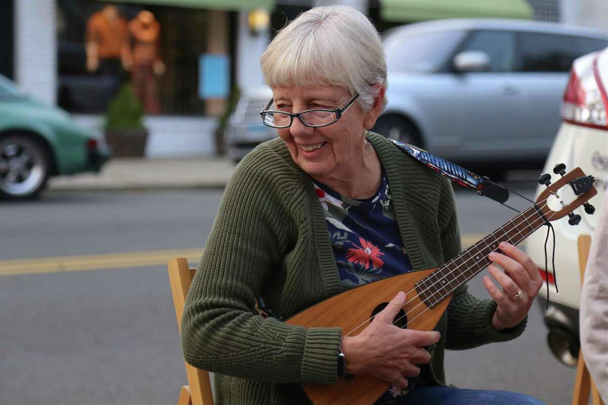 """Vikki Herman of Fairfield is a regular at the monthly ukulele meet-up outisde the Horseshoe Cafe on Tuesday, Sept.15, 2020, in Fairfield, Conn. Vikki Herman of Fairfield, who has been attending the group for two years with her husband Bill, praised Forlano and his inclusive approach to making music. """"He is so welcoming to everyone in the group,"""" she said, """"whether you're a beginner or an expert."""" Likewise, she said she greatly appreciates the chance to keep playing their gigs together, despite the challenges of virus-related restrictions. """"We can still be together,"""" she said. """"I look forward to it. It's just the best thing I do."""""""