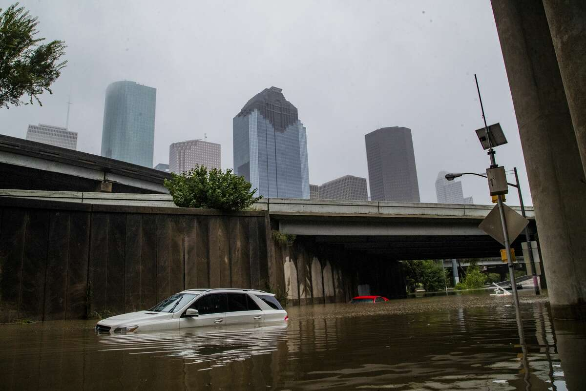 Cars get stranded on high flood waters on Houston Ave. exit from interstate 45 during Tropical Storm Beta Tuesday, Sept. 22, 2020, in Houston.