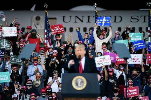 Supporters cheer as President Donald Trump speaks during a campaign event at Fayetteville Regional Airport on Saturday in North Carolina.