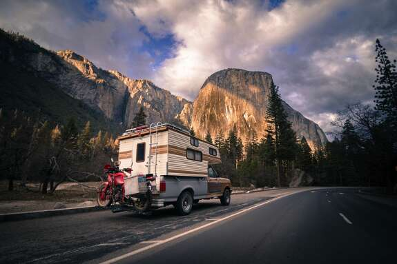 Camper van driving towards Yosemite National Park, California, USA