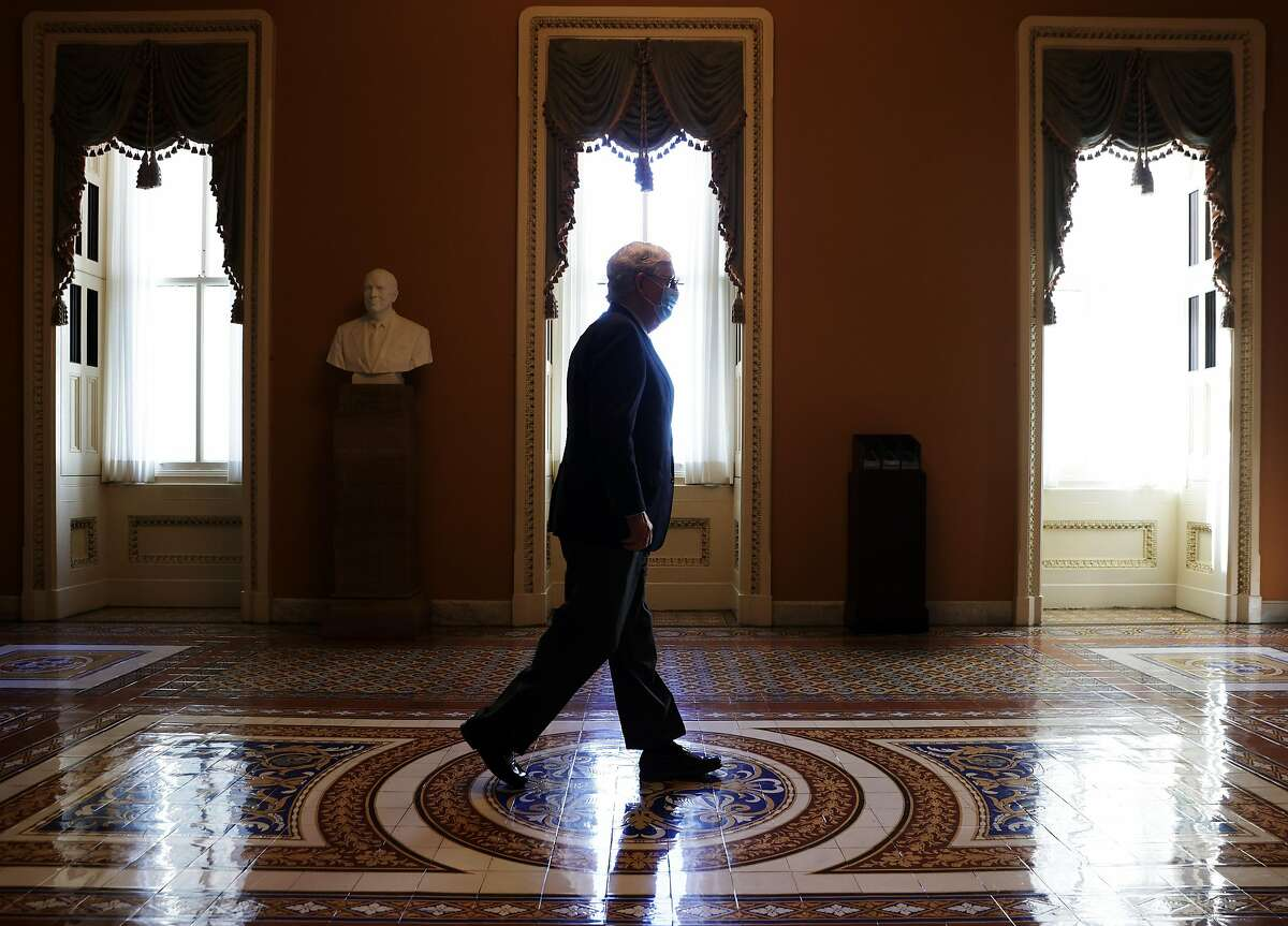 WASHINGTON, DC - SEPTEMBER 21: U.S. Senate Majority Leader Sen. Mitch McConnell (R-KY) walks in a hallway at the U.S. Capitol September 21, 2020 in Washington, DC. In a statement on the passing of U.S. Supreme Court Justice Ruth Bader Ginsburg, McConnell said President Trumps nominee for the bench will receive a vote in the U.S. Senate. (Photo by Alex Wong/Getty Images) ***BESTPIX***
