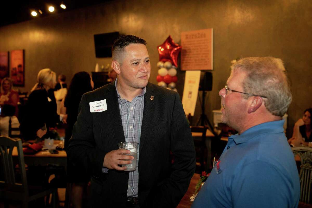 Tony Gonzales, left, introduces himself to an attendee at a Midland event held Aug. 31. At a Thursday debate, the Republican cadidate for 23rd Congressional District seemed determined to stand pretty far from Trump, columnist Gilbert Garcia points out.