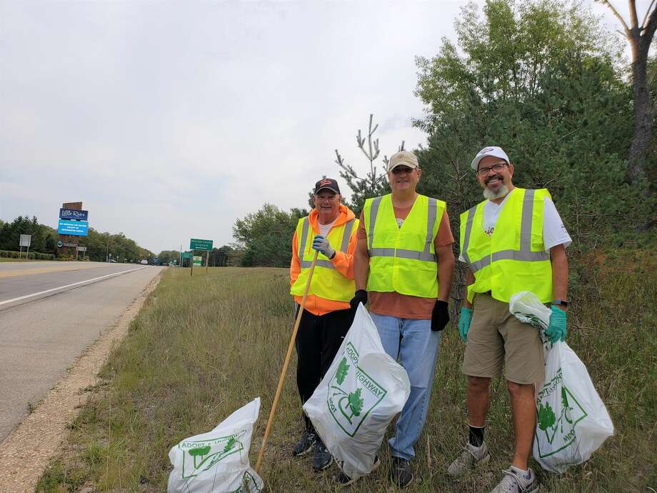 """Manistee Senior Softball team players Bill """"Hammer"""" Mason, Roger """"Smokey"""" Elbers and Dave """"Van Gogh"""" Crockett stood for a photo as they cleaned a section of U.S. 31 near the corner of M-22 on Tuesday morning. Photo: Arielle Breen/News Advocate"""