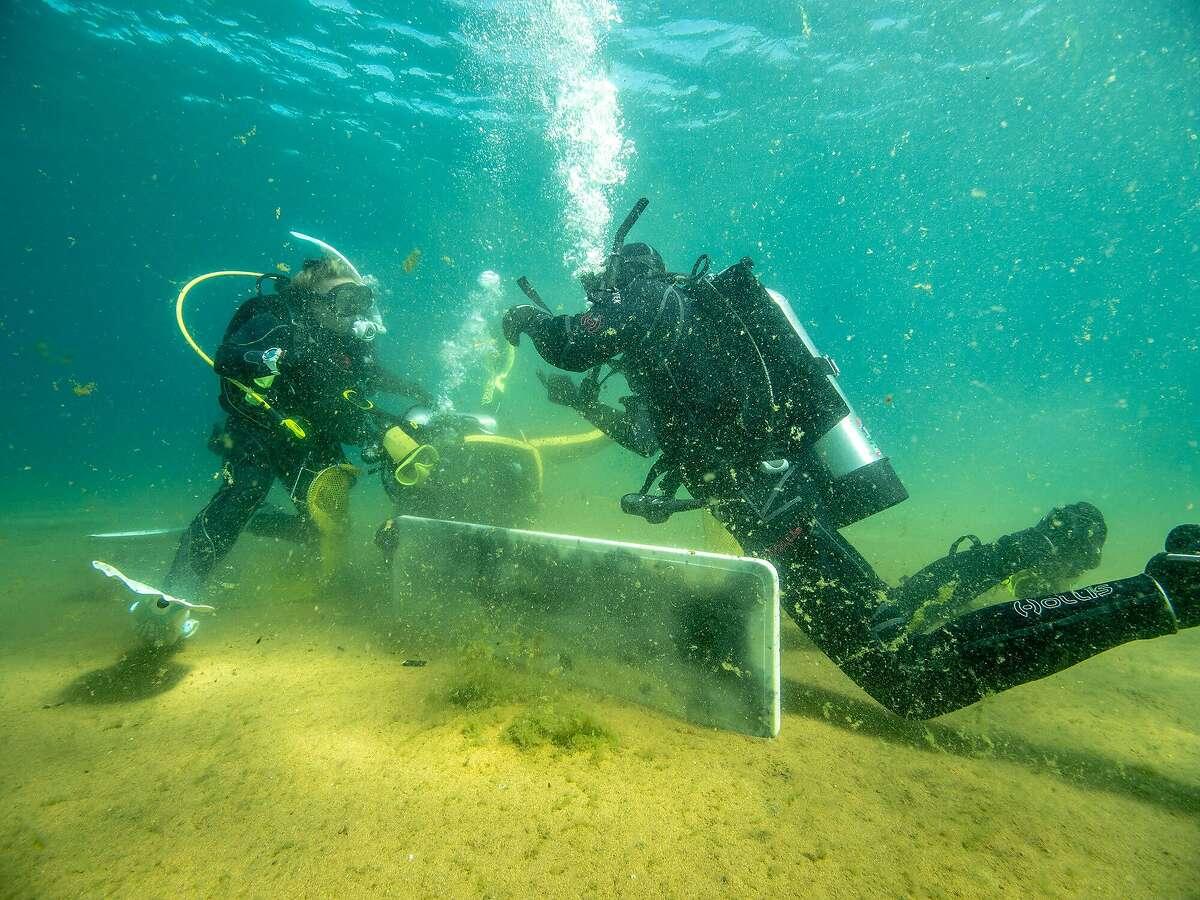 Scuba divers pick up trash in Lake Tahoe near Nevada Beach on Thursday, Aug. 27, 2020.
