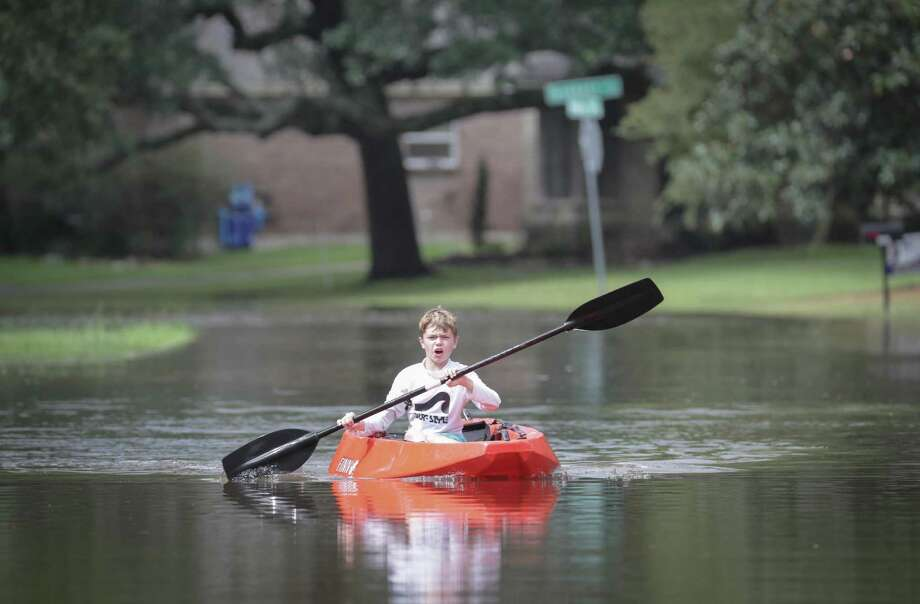 Josey Chambers, 11, makes his way on a kayak up Wandering Trail after Clear Creek overflowed as Tropical Storm Beta trained over the area Tuesday, Sept. 22, 2020, in Friendswood. Photo: Steve Gonzales, Houston Chronicle / Staff Photographer / © 2020 Houston Chronicle