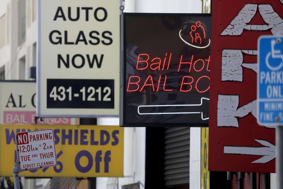 Several bail bond company signs seen across the street from the Hall of Justice on Tuesday, Sept. 22, 2020, in San Francisco, Calif.