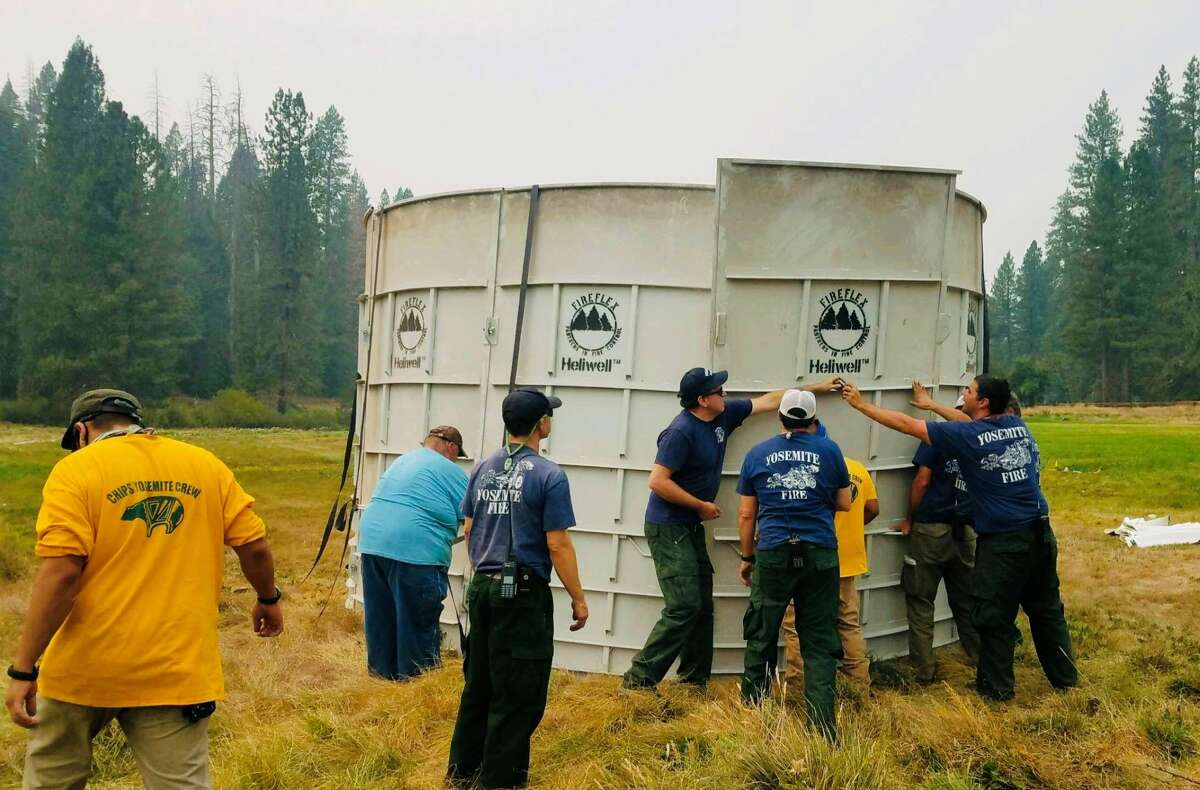 Near the Mariposa Grove, CHIPS crew members help build a tub that will hold water a helicopter can easily scoop up.