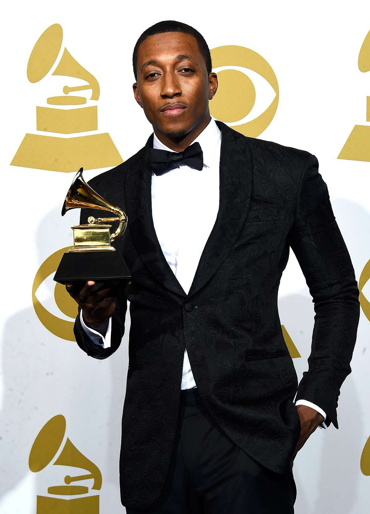 LOS ANGELES, CA - FEBRUARY 08: Rapper Lecrae, winner of Best Contemporary Christian Music Performance/Song for 'Messengers,' poses in the press room during The 57th Annual GRAMMY Awards at the STAPLES Center on February 8, 2015 in Los Angeles, California. (Photo by Frazer Harrison/Getty Images)