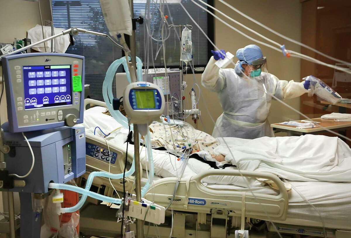 Katherine Hogan attends to a covid patient at Northeast Baptist Hospital in the Covid ICU, on Wednesday, May 27, 2020.