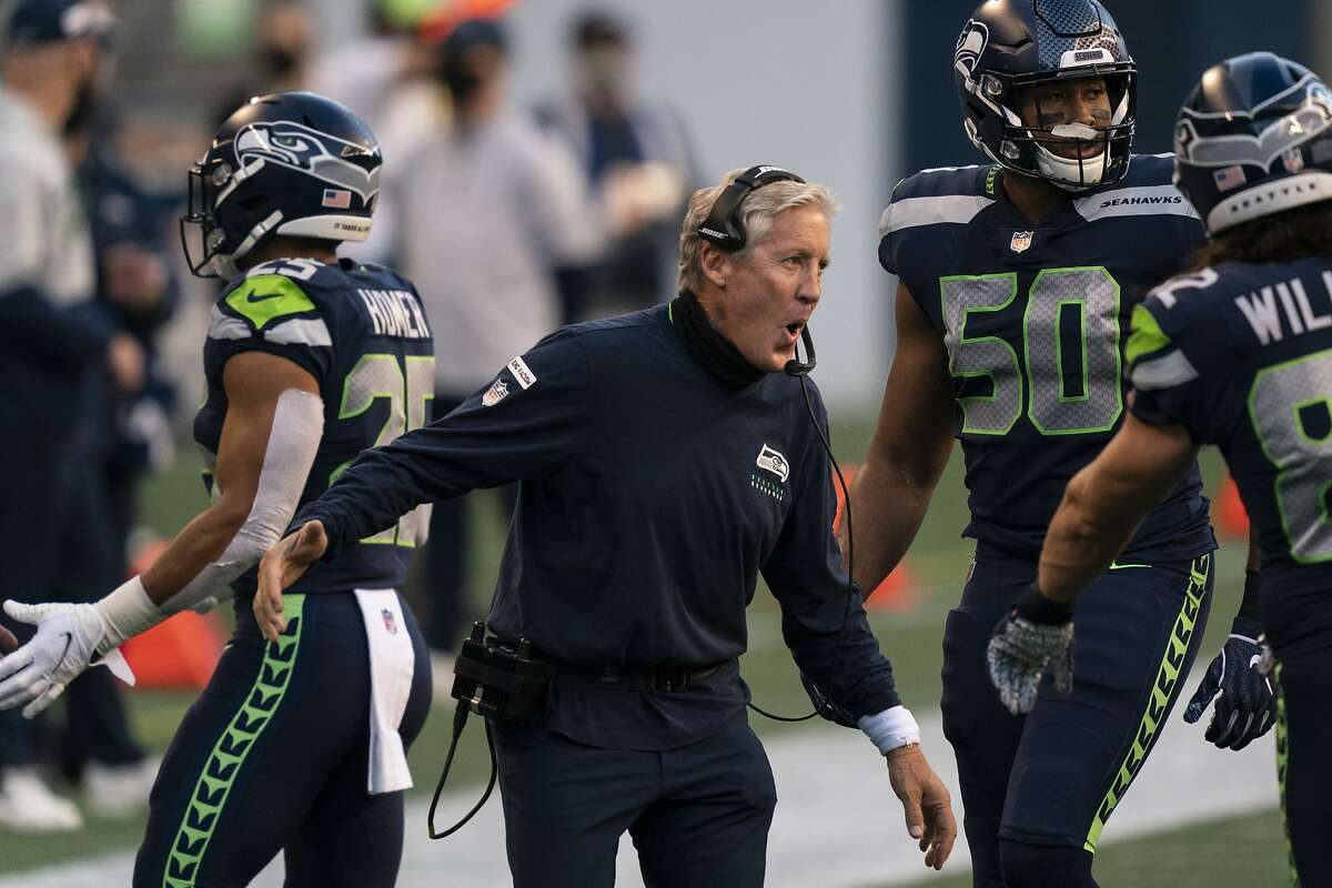 Seattle Seahawks head coach Pete Carroll celebrates after a touchdown during the first half an NFL football game against the New England Patriots, Sunday, Sept. 20, 2020, in Seattle. The Seahawks won 35-30. (AP Photo/Stephen Brashear)