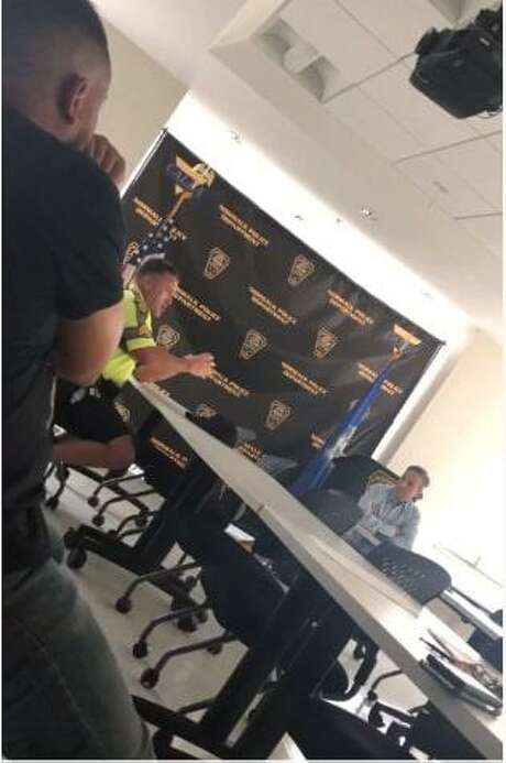 A screenshotfrom a recently released video shows former Norwalk Police Union president Sgt. David Orr and state Sen. Bob Duff speaking at Norwalk police headquarters on July 24.