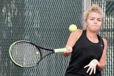 Edwardsville's Jensen Weedman hits a forehand shot during her singles match against Collinsville on Tuesday at the EHS Tennis Center.