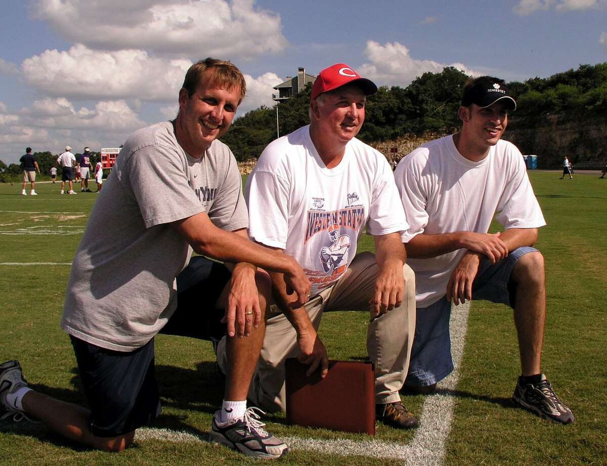 Sonny Detmer, middle, and his sons, Ty, left, and Koy Detmer, who have many years of NFL experience between them. They are currently running the Ty & Koy Detmer Football Camp at Cornerstone Christian School. The camp runs through Friday, and students are still being accepted. Wednesday, July 7, 2004. BILLY CALZADA / STAFF