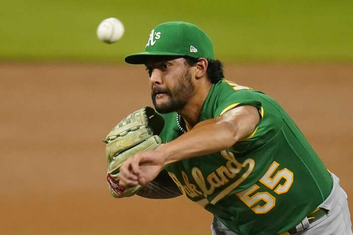 Oakland Athletics starting pitcher Sean Manaea throws against the Colorado Rockies during the fourth inning of a baseball game, Monday Sept. 15, 2020, in Denver. (AP Photo/Jack Dempsey)