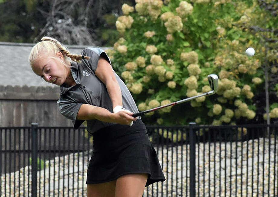 Edwardsville senior Sydney Weedman hits her tee shot off the par-3 third hole at Tamarack Country Club on Tuesday in the O'Fallon Invitational. Photo: Matt Kamp|The Intelligencer