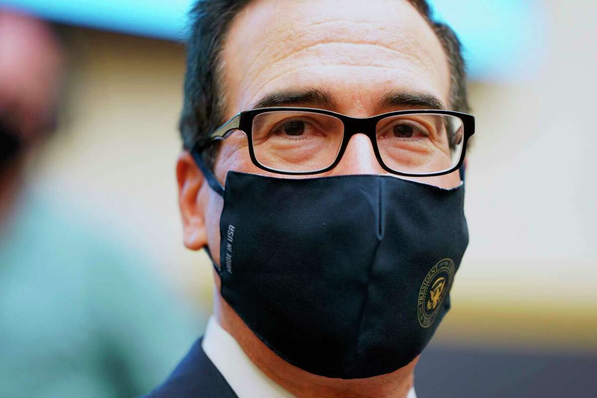 Treasury Secretary Steven Mnuchin wears a face mask as he arrives for a House Financial Services Committee hearing about the governmenta€™s emergency aid to the economy in response to the coronavirus on Capitol Hill in Washington on Tuesday, Sept. 22, 2020. (Joshua Roberts/Pool via AP)
