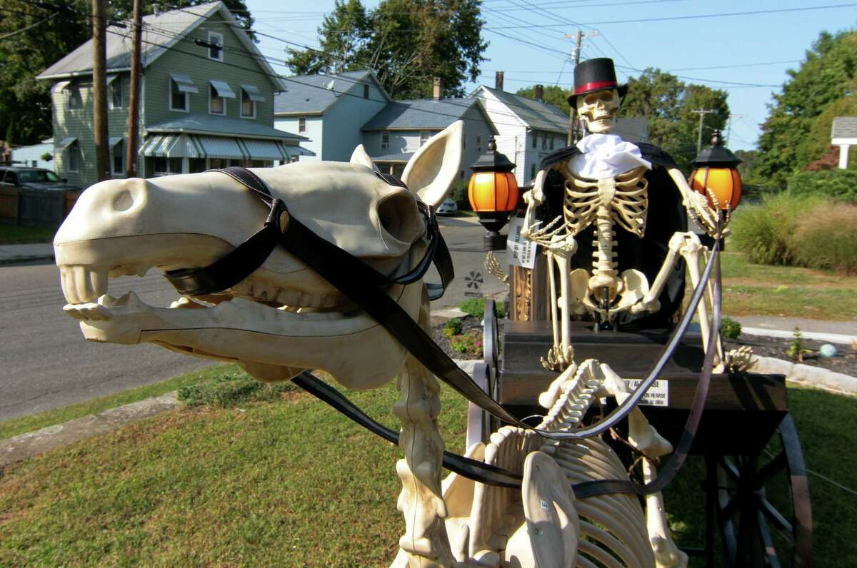 A view of a Halloween display in front of a home on Hawkins Street in Derby.