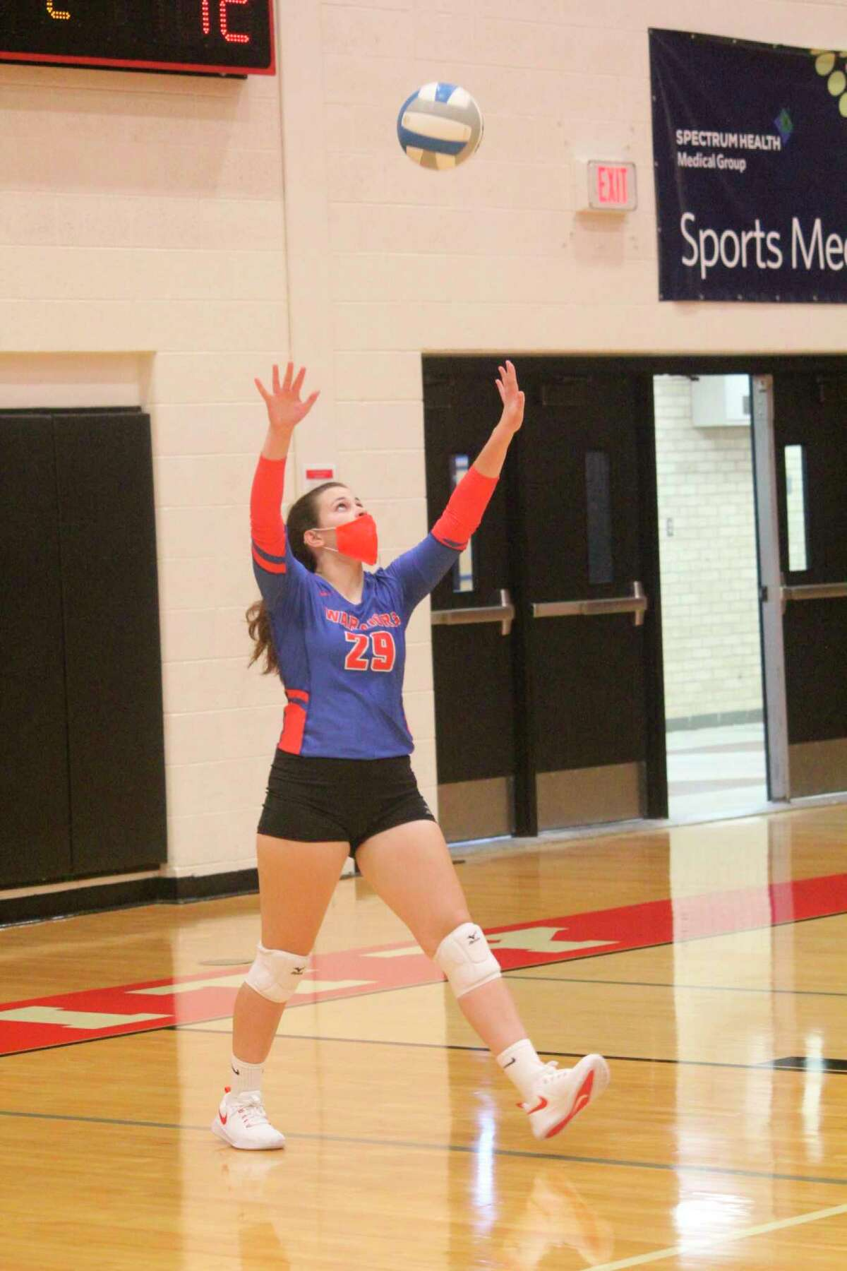 Chippewa Hills' Madey Newman gets set to serve the ball against Reed City in Tuesday's CSAA Gold match. (Pioneer photo/John Raffel)