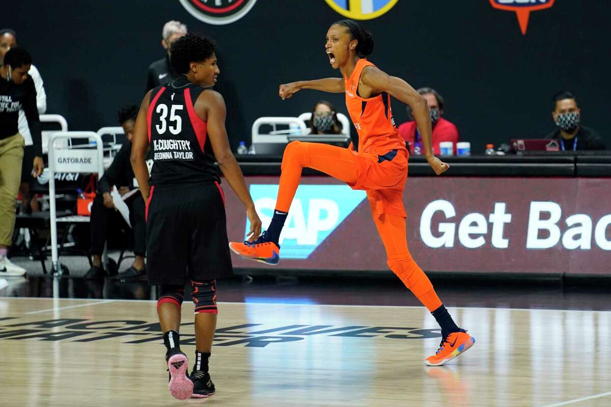 Connecticut Sun forward DeWanna Bonner (24) celebrates her three-point basket in front of Las Vegas Aces forward Angel McCoughtry (35) during the second half of Game 2 of a WNBA basketball semifinal round playoff game Tuesday, Sept. 22, 2020, in Bradenton, Fla. (AP Photo/Chris O'Meara)