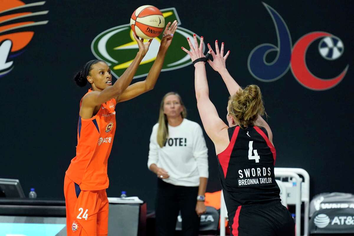 The Sun's DeWanna Bonner (24) shoots a 3-point basket over the Aces' Carolyn Swords (4) during the second half of Game 2 on Tuesday in Bradenton, Fla.