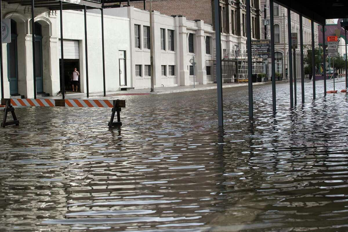 Water fills the street in The Strand from the tidal surge of Tropical Storm Beta in The Strand as the storm moves toward landfall Tuesday, Sept. 22, 2020 in Galveston. ( Brett Coomer / Houston Chronicle )