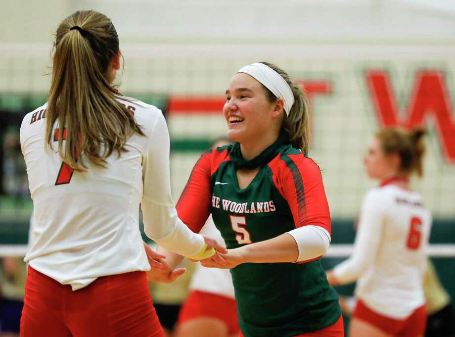 In this file photo, The Woodlands libero Jacqueline Lee (5) gives a high-five to outside hitter Claire Arend (7) during the third set of a non-district high school volleyball match at The Woodlands High School, Friday, Sept. 18, 2020, in The Woodlands. Photo: Jason Fochtman, Houston Chronicle / Staff Photographer / 2020 © Houston Chronicle