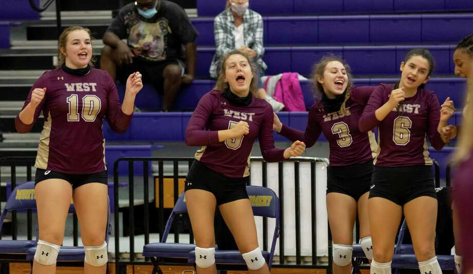 Magnolia West High School's bench reacts after their team scores during the second set of a non-district volleyball match at Montgomery High School, Tuesday, Sept. 22, 2020. Photo: Gustavo Huerta, Houston Chronicle / Staff Photographer / 2020 © Houston Chronicle