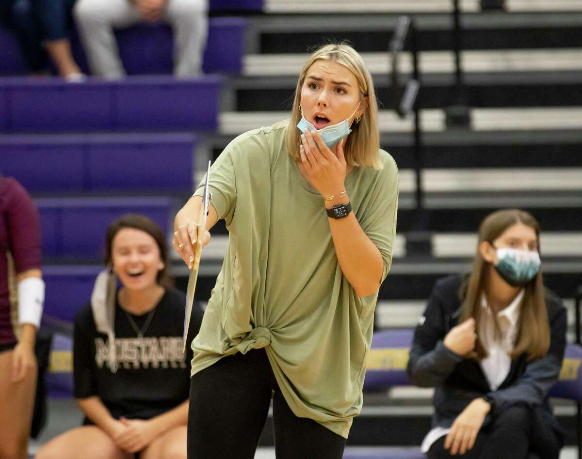 Magnolia West head coach Jordan McArdle talks to her team during the third set of a non-district volleyball match at Montgomery High School, Tuesday, Sept. 22, 2020.