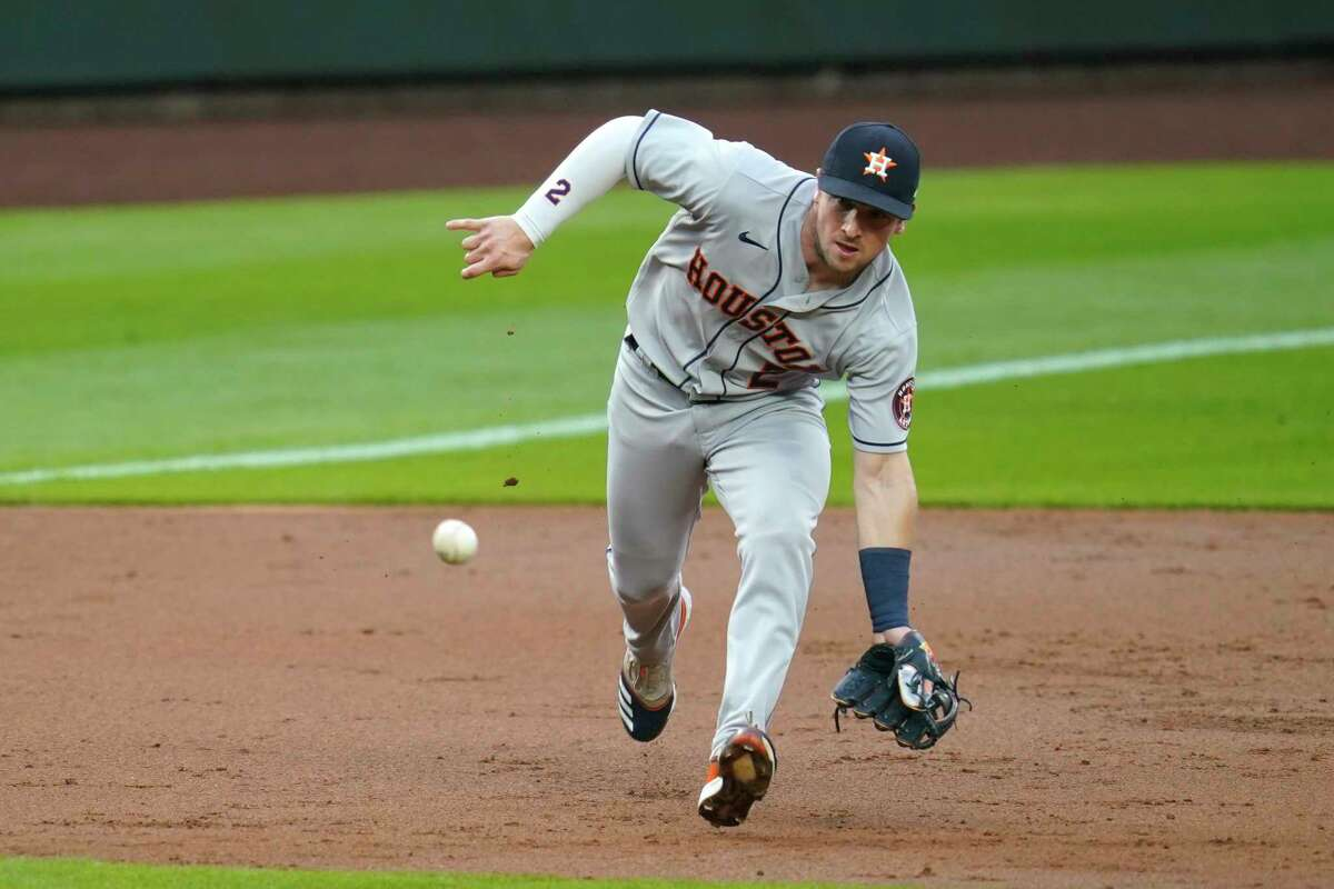 Houston Astros third baseman Alex Bregman chases a grounder from Seattle Mariners' Ty France in the first inning of a baseball game Tuesday, Sept. 22, 2020, in Seattle. Bregman made the play on France for the out. (AP Photo/Elaine Thompson)