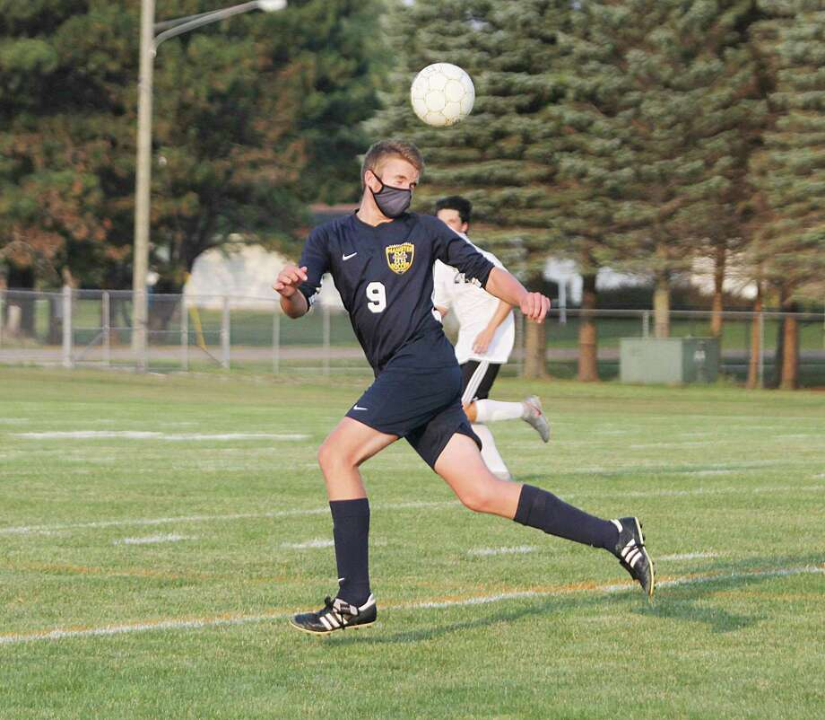 Manistee senior Mason Adamski heads the ball during the Chippewas' home opener on Tuesday. (Dylan Savela/News Advocate)