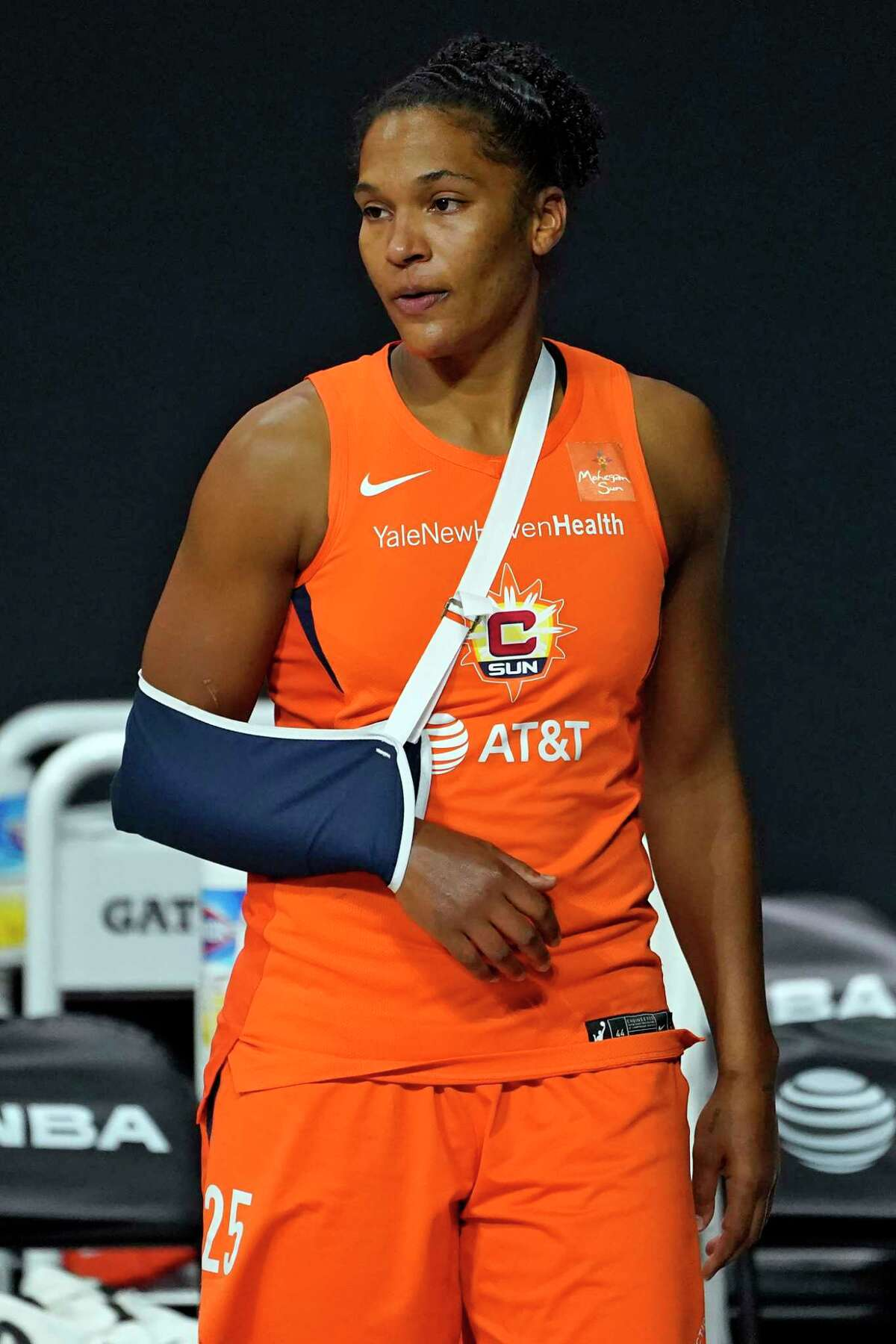 Connecticut Sun forward Alyssa Thomas watches from the bench after being injured during Game 2 of a semifinal-round playoff series against the Las Vegas Aces on Tuesday.