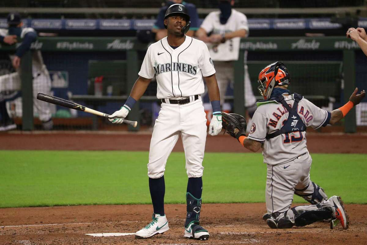 SEATTLE, WASHINGTON - SEPTEMBER 22: Kyle Lewis #1 of the Seattle Mariners reacts while at bat in the fifth inning against the Houston Astros at T-Mobile Park on September 22, 2020 in Seattle, Washington.