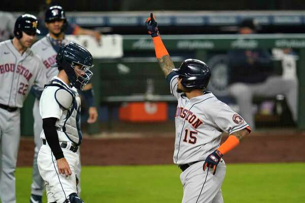 Houston Astros' Martin Maldonado (15) motions as he crosses home plate in front of Seattle Mariners catcher Luis Torrens on his three-run home run during the sixth inning of a baseball game Tuesday, Sept. 22, 2020, in Seattle. (AP Photo/Elaine Thompson)