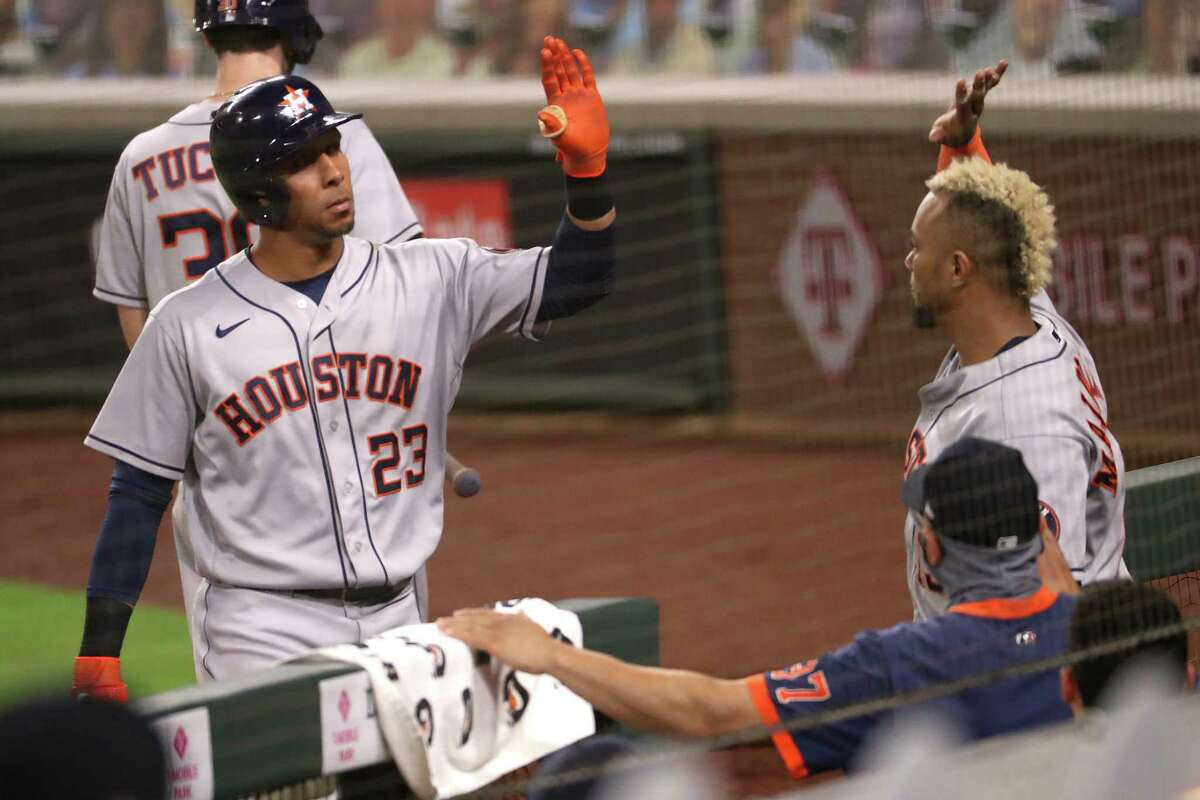 SEATTLE, WASHINGTON - SEPTEMBER 22: Michael Brantley #23 of the Houston Astros celebrates his solo home run with Martin Maldonado #15 to take a 2-1 lead in the sixth inning against the Seattle Mariners at T-Mobile Park on September 22, 2020 in Seattle, Washington.