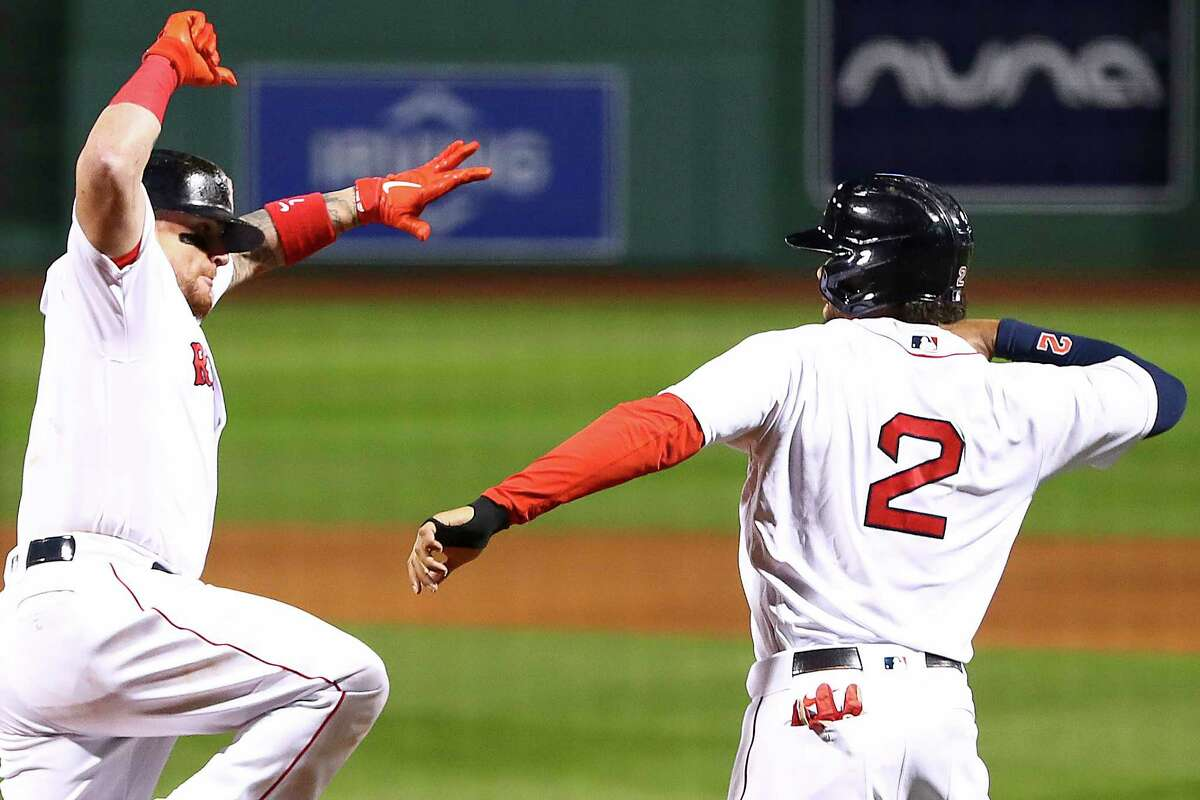 BOSTON, MA - SEPTEMBER 22: Christian Vazquez #7 reacts with Xander Bogaerts #2 of the Boston Red Sox after hitting a three-run home run in the sixth inning of a game against the Baltimore Orioles at Fenway Park on September 22, 2020 in Boston, Massachusetts. (Photo by Adam Glanzman/Getty Images)
