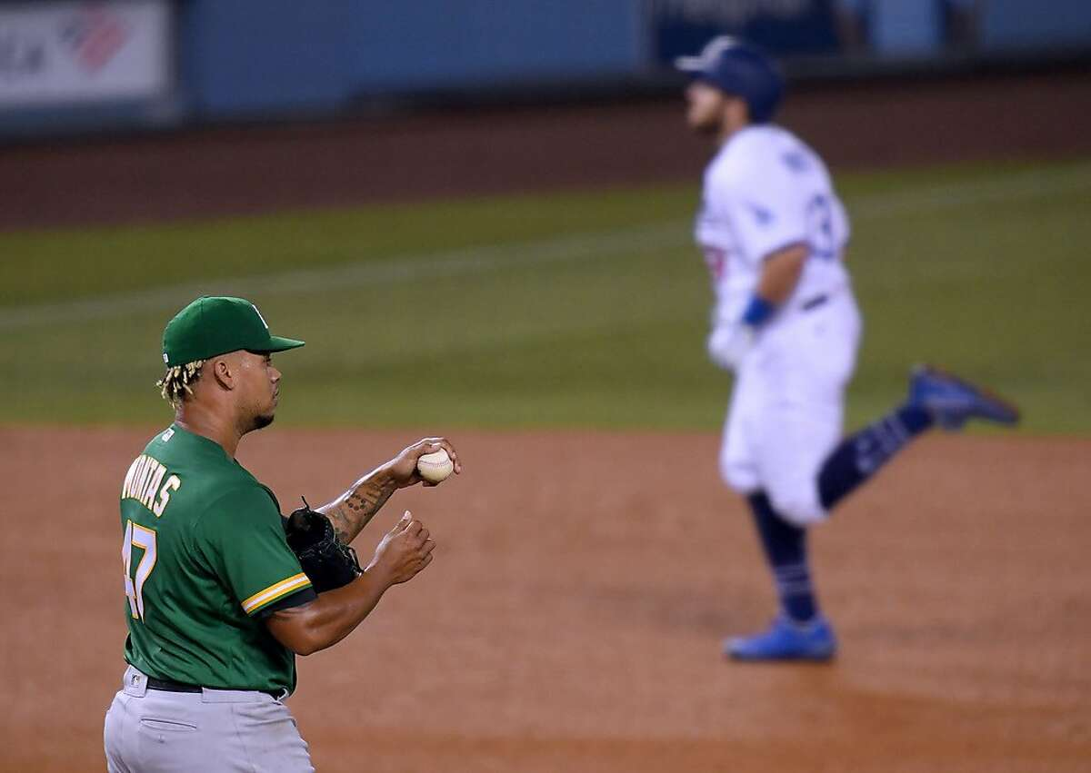 LOS ANGELES, CALIFORNIA - SEPTEMBER 22: Frankie Montas #47 of the Oakland Athletics reacts after a two run homerun from Max Muncy #13 of the Los Angeles Dodgers, to take a 3-2 lead, during the third inning at Dodger Stadium on September 22, 2020 in Los Angeles, California. (Photo by Harry How/Getty Images)