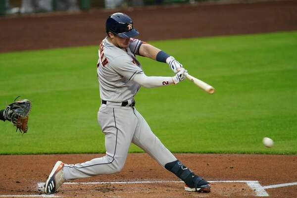 Houston Astros' Alex Bregman singles against the Seattle Mariners in a baseball game Tuesday, Sept. 22, 2020, in Seattle. (AP Photo/Elaine Thompson)