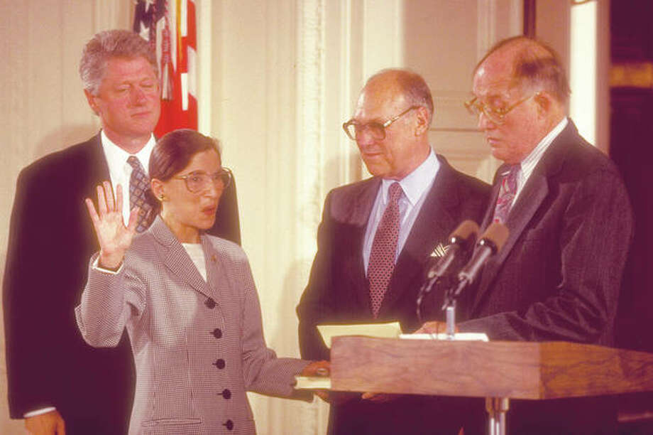 Supreme Court Chief Justice William Rehnquist (right) swears in new Supreme Court Justice Ruth Bader Ginsburg in 1993 as her husband, Martin, and President Bill Clinton look on. Photo: Dirck Halstead | The Life Photo Collection
