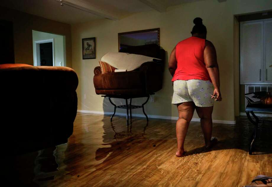 Brenda Duckworth walks through her home which has about three inches of water due to Tropical Storm Beta on Tuesday, Sept. 22, 2020, in Houston. She and her husband raised their furniture to try to avoid water damage. Photo: Godofredo A. Vásquez, Houston Chronicle / Staff Photographer / © 2020 Houston Chronicle