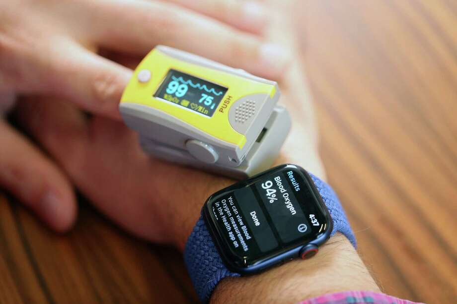 We tested blood oxygen saturation simultaneously on the Apple Watch 6 and with an FDA-approved Medline finger pulse oximeter with an error rate of plus or minus two percentage points. Sometimes the results were wildly different. Photo: Washington Post Photo By Jonathan Baran. / The Washington Post