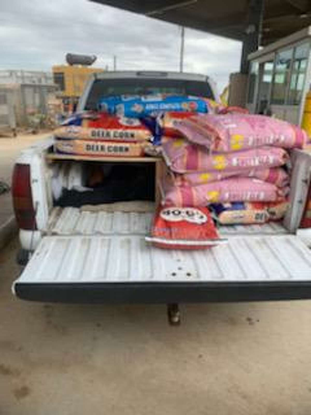 U.S. Border patrol agents found four people inside a compartment hidden underneath bags of deer corn, horse feed and dog food. The individuals were determined to be immigrants who had crossed the border illegally.