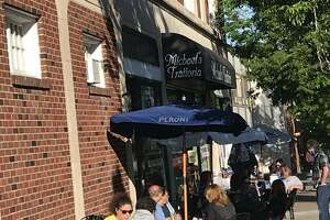 Patrons dine outside Michael's Trattoria in Wallingford in May. The Town Council voted Tuesday night to extend the period of time that restaurants on Main and Center streets can offer sidewalk dining.