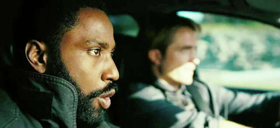 "John David Washington, foreground, and Robert Pattinson, background, in ""Tenet."" Photo: Coutesy Warner Bros.