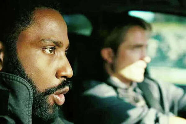 "John David Washington, foreground, and Robert Pattinson, background, in ""Tenet."""